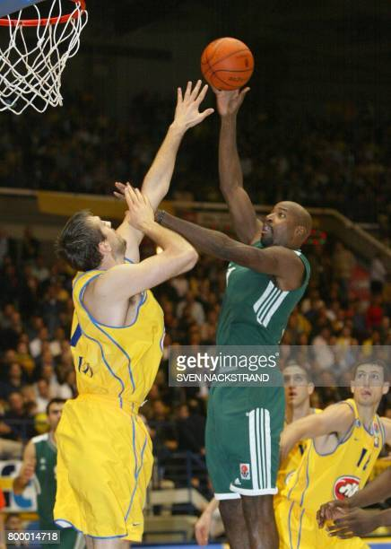 Charles Middleton of Panathinaikos Athens Greece tries to score as Nicola Vujcic of Maccabi Tel Aviv blocks him during their Euroleague basketball...