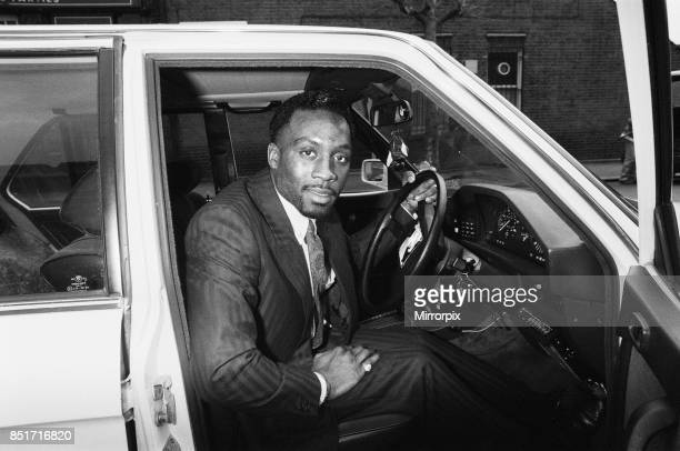 Middleweight boxer Nigel Benn posing with his 3 series BMW Circa 1987