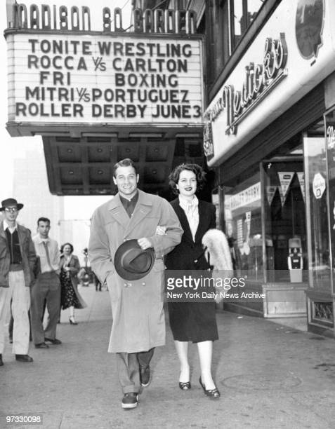 Middleweight boxing champ of Europe Tiberio Mitri and wife Fulvia former Miss Italy of 1948 walk under the Madison Square Garden marquee on Eighth Ave