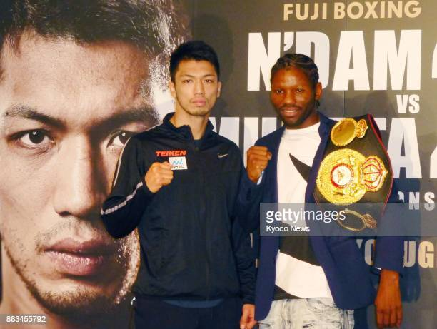 WBA middleweight boxing champion Hassan N'Dam of France and Japanese challenger Ryota Murata pose for a photo in Tokyo on Oct 20 after signing for...