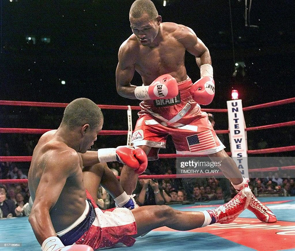 Middleweight Champion Bernard Hopkins of the US knocks down WBA Champion Felix Trinidad of Puerto Rico in the 11th round during their 12 round...
