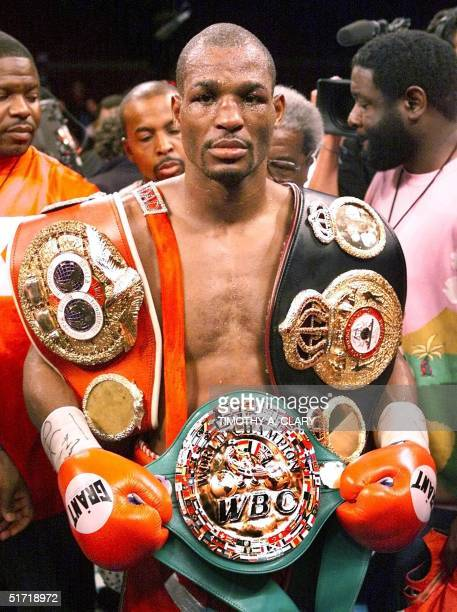 Middleweight Champion Bernard Hopkins of the US wears his three belts after defeating WBA Champion Felix Trinidad of Puerto Rico in their 12round...