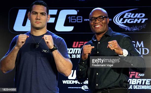 UFC middleweight champion Chris Weidman and former middleweight champion Anderson Silva pose for the media during the UFC 168 Weidman v SIlva 2 press...