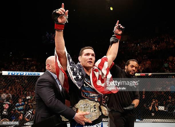 UFC middleweight champion Chris Weidman celebrates his win over Lyoto Machida in their UFC middleweight championship fight during the UFC 175 event...