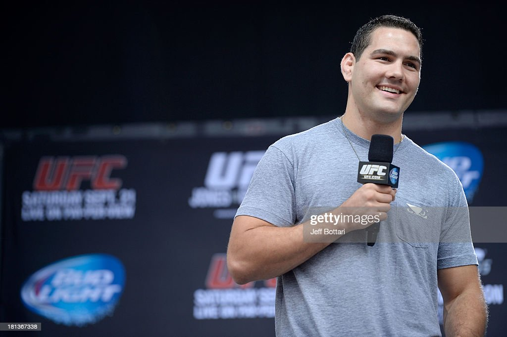 Middleweight Champion <a gi-track='captionPersonalityLinkClicked' href=/galleries/search?phrase=Chris+Weidman&family=editorial&specificpeople=7529861 ng-click='$event.stopPropagation()'>Chris Weidman</a> interacts with fans during a Q&A session before the UFC 165 weigh-in at the Maple Leaf Square on September 20, 2013 in Toronto, Ontario, Canada.