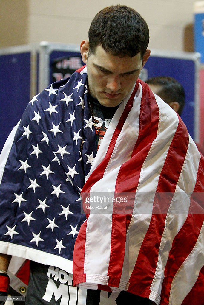 Middleweight Champion Chris Weidman looks on prior to his middleweight championship bout against Anderson Silva during the UFC 168 event at the MGM Grand Garden Arena on December 28, 2013 in Las Vegas, Nevada.