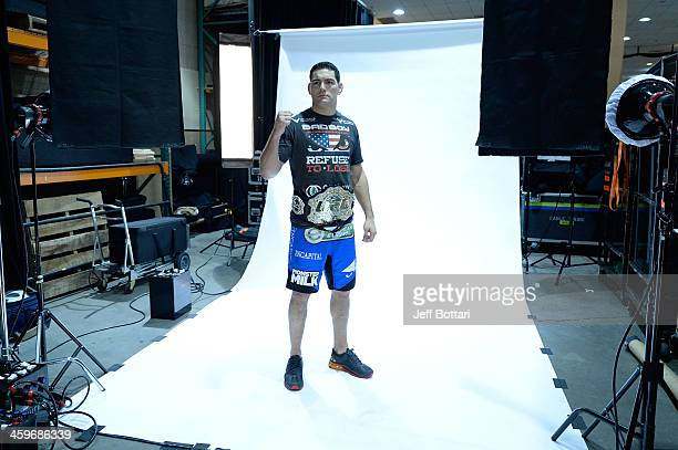 Middleweight Champion Chris Weidman poses for a postfight portrait after defeating Anderson Silva by TKO during the UFC 168 event at the MGM Grand...