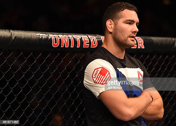 UFC middleweight champion Chris Weidman reacts after his teammate Gian Villante's TKO loss to Tom Lawlor in their light heavyweight bout during the...
