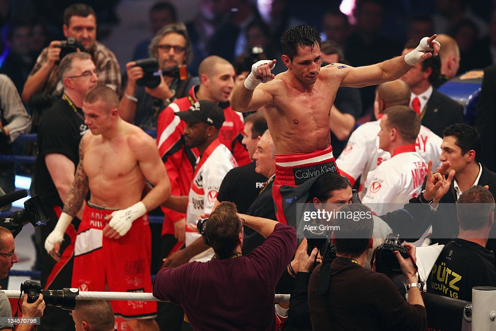 WBA middleweight champion <a gi-track='captionPersonalityLinkClicked' href=/galleries/search?phrase=Felix+Sturm&family=editorial&specificpeople=171389 ng-click='$event.stopPropagation()'>Felix Sturm</a> and challenger Martin Murray of Great Britain react after their WBA middleweight World Championship fight at SAP Arena on December 2, 2011 in Mannheim, Germany.
