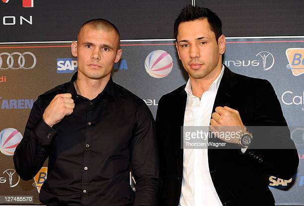 WBA middleweight champion Felix Sturm and defender Martin Murray look on during a press conference at SAP Arena on September 28 2011 in Mannheim...