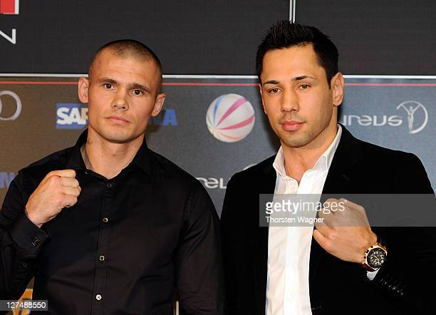 WBA middleweight champion Felix Sturm and his defender Martin Murray look on during a press conference at SAP Arena on September 28 2011 in Mannheim...