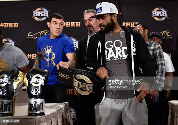 BKB middleweight champion Gabriel Rosado and Curtis Stevens each grab the championship belt at a BKB 2 news conference at the Mandalay Bay Events...