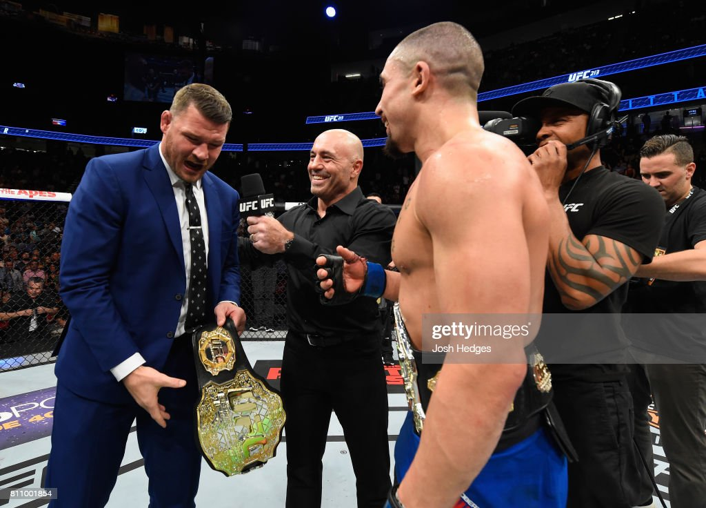 UFC middleweight champion Michael Bisping challenges newly crowned interim UFC middleweight champion Robert Whittaker of New Zealand after his victory over Yoel Romero during the UFC 213 event at T-Mobile Arena on July 8, 2017 in Las Vegas, Nevada.
