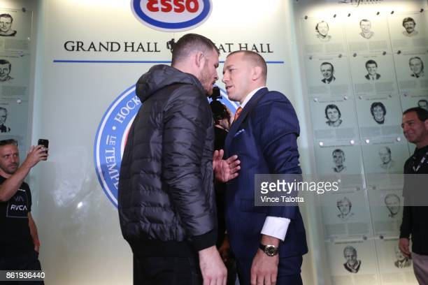 TORONTO ON OCTOBER 13 Middleweight champion Michael Bisping goes nose to nose with Canadian Georges StPierre in Friday's UFC 217 teaser at the Hockey...