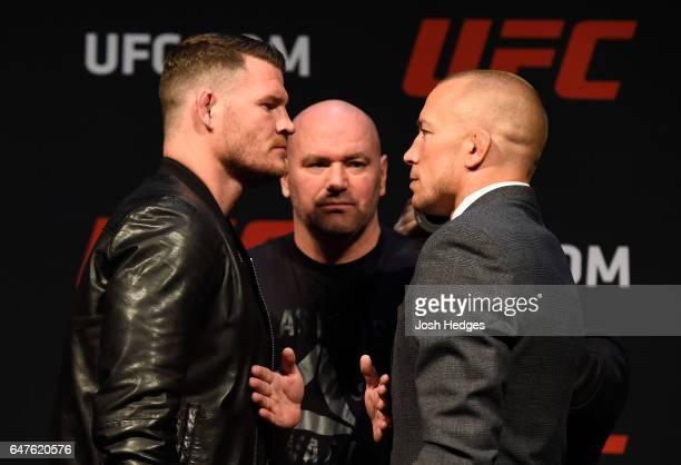 UFC middleweight champion Michael Bisping of England faces off against Georges StPierre of Canada during the UFC press conference at TMobile arena on...