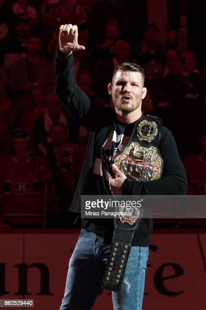 UFC middleweight champion Michael Bisping reacts prior to the NHL game between the Montreal Canadiens and the Toronto Maple Leafs at the Bell Centre...