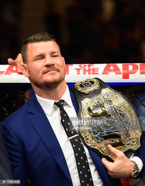 UFC middleweight champion Michael Bisping stands in the Octagon after the conclusion of the interim UFC middleweight championship bout between Yoel...