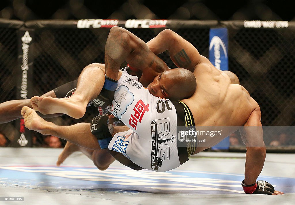 TORONTO, ON- SEPTEMBER 21 - Middleweight Francis Carmontat from Montreal takes down Costa Philippou from Long Island at UFC 165 at the Air Canada Centre in Toronto, September 21, 2013.