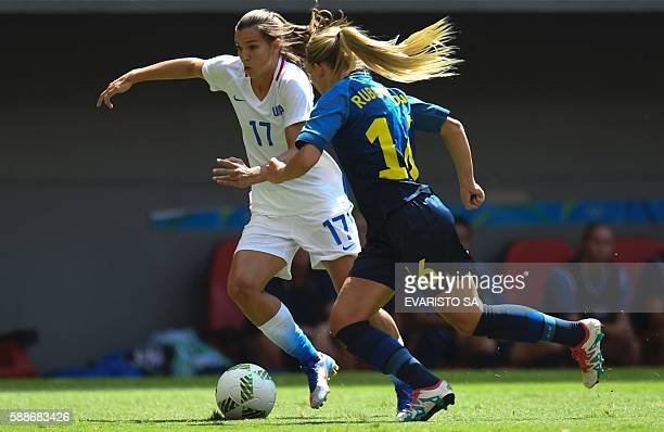 US midfield Tobin Heath vies for the ball with Sweden defender Magdalena Eriksson during the Rio 2016 Olympic Games Quarterfinals women's football...