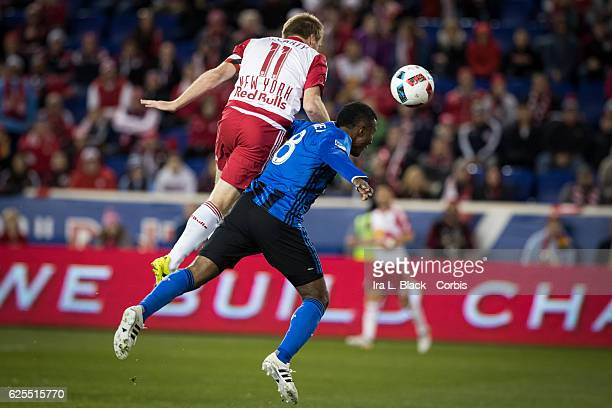 Midfielder and Captain Patrice Bernier of the Montreal Impact goes up for the ball against Captain Dax McCarty of the New York Red Bulls during the...
