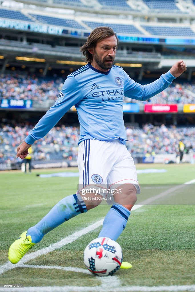 Midfielder Andrea Pirlo #21 of New York City FC takes a corner kick during the match against D.C. United at Yankee Stadium on March 12, 2017 in the Bronx borough of New York City. New York City FC deafeats D.C. United 4-0.