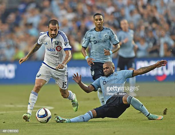 Midfielder Andres Romero of the Montreal Impact dribbles past defender Kevin Ellis of Sporting Kansas City during the first half on July 18 2015 at...