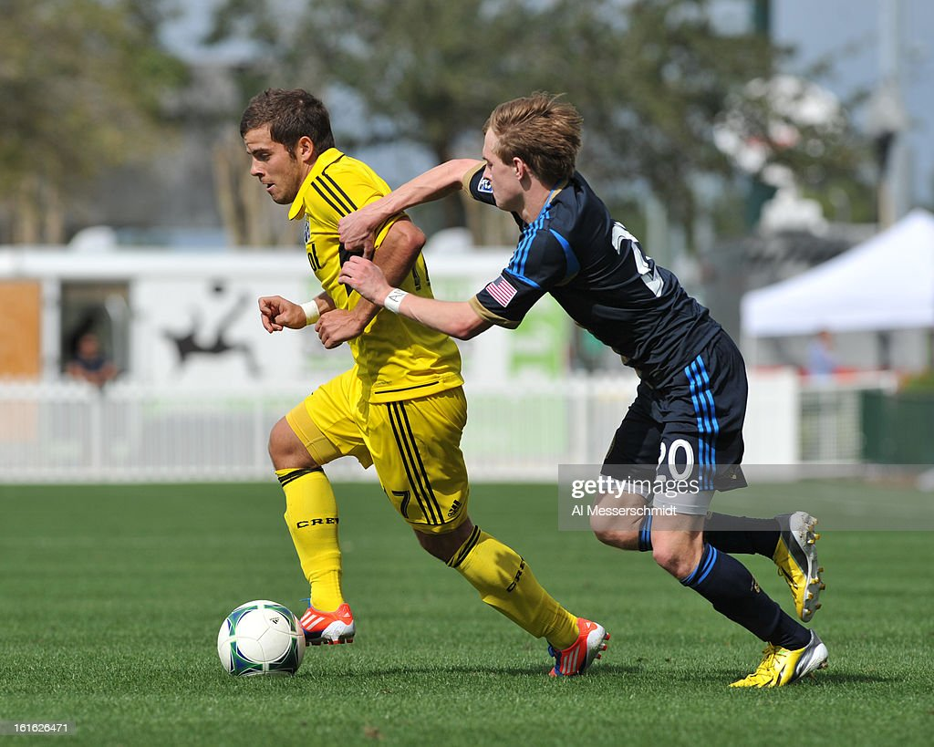 Midfielder Ben Speas #17 of the Philadelphia Union runs past midfielder Jimmy McLaughlin #20 of the Columbus Crew February 13, 2013 in the second round of the Disney Pro Soccer Classic in Orlando, Florida.