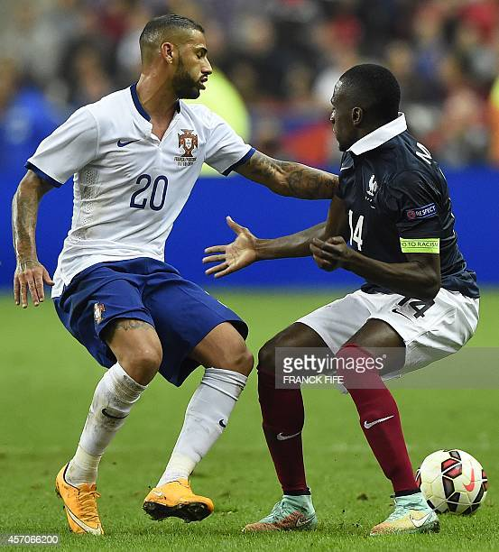 midfielder Blaise Matuidi vies with Portugal's forward Ricardo Quaresma during the friendly football match France vs Portugal on October 11 2014 at...
