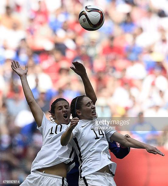 USA midfielder Carli Lloyd and USA midfielder Morgan Brian jump for the ball during the final football match between USA and Japan during their 2015...