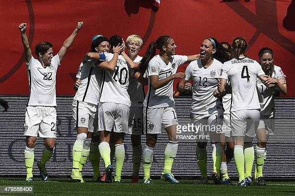 USA midfielder Carli Lloyd is congratuled by after scoring a goal during the final football match between USA and Japan during their 2015 FIFA...