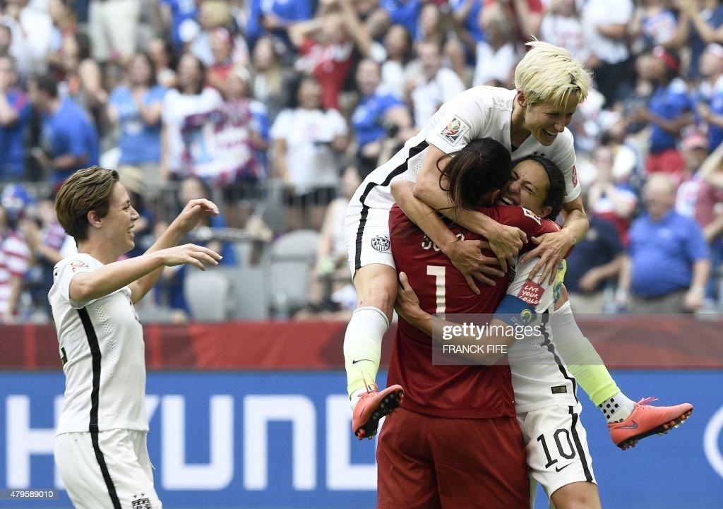 USA midfielder Carli Lloyd is congratuled by goalkeeper Hope Solo and midfielder Megan Rapinoe after scoring a goal during the final football match...