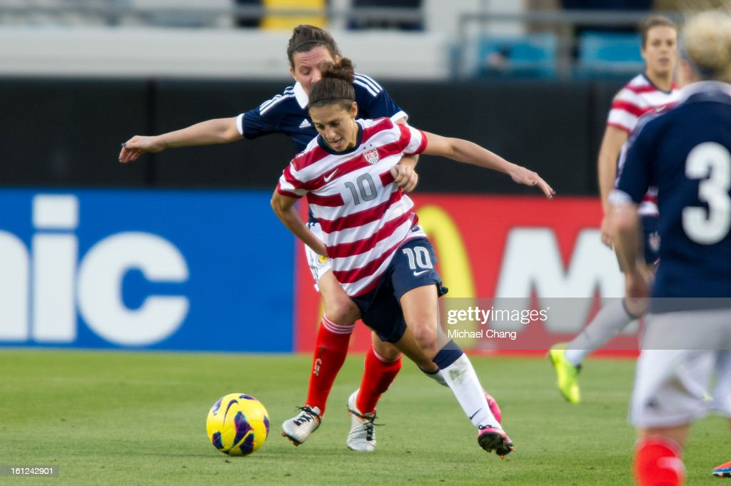 Midfielder <a gi-track='captionPersonalityLinkClicked' href=/galleries/search?phrase=Carli+Lloyd&family=editorial&specificpeople=736799 ng-click='$event.stopPropagation()'>Carli Lloyd</a> #10 of the United State and midfielder Leanne Crichton #14 of Scotland battle for the ball at EverBank Field on February 9, 2013 in Jacksonville, Florida. The United States defeated Scotland 4-1.