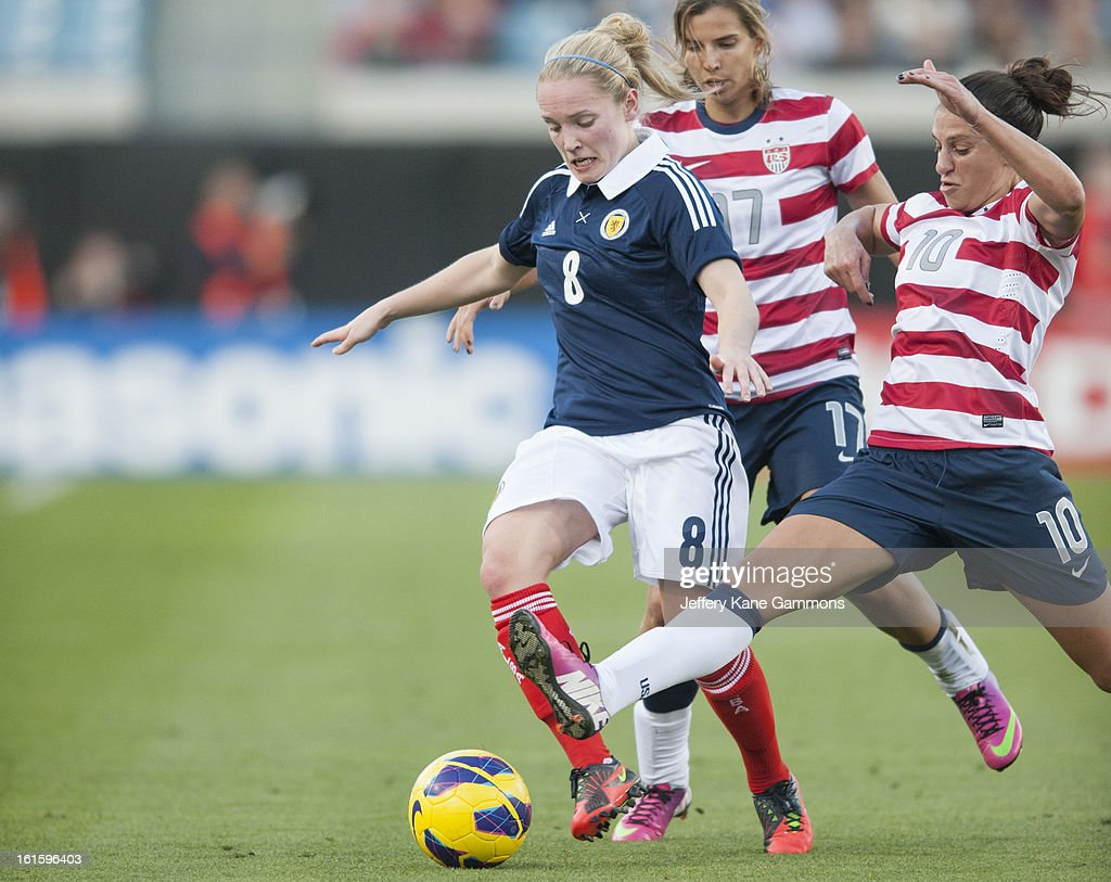 Midfielder Carli Lloyd #10 of the United States attempts to steal the ball from Midfielder Kim Little #8 of Scotland during the game at EverBank Field on February 9, 2013 in Jacksonville, Florida.
