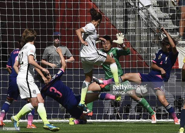 USA midfielder Carli Lloyd scores a goal during the final football match between USA and Japan during their 2015 FIFA Women's World Cup at the BC...