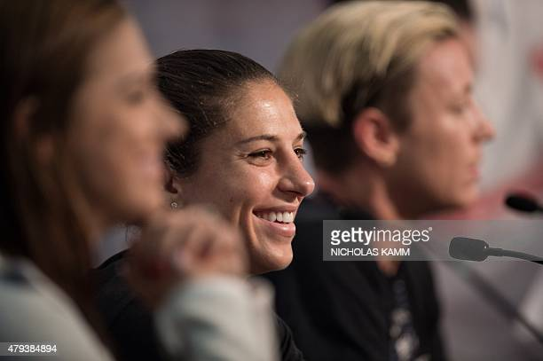 US midfielder Carli Lloyd smiles during a press conference with teammates Alex Morgan and Abby Wambach in Vancouver on July 3 two days before the...