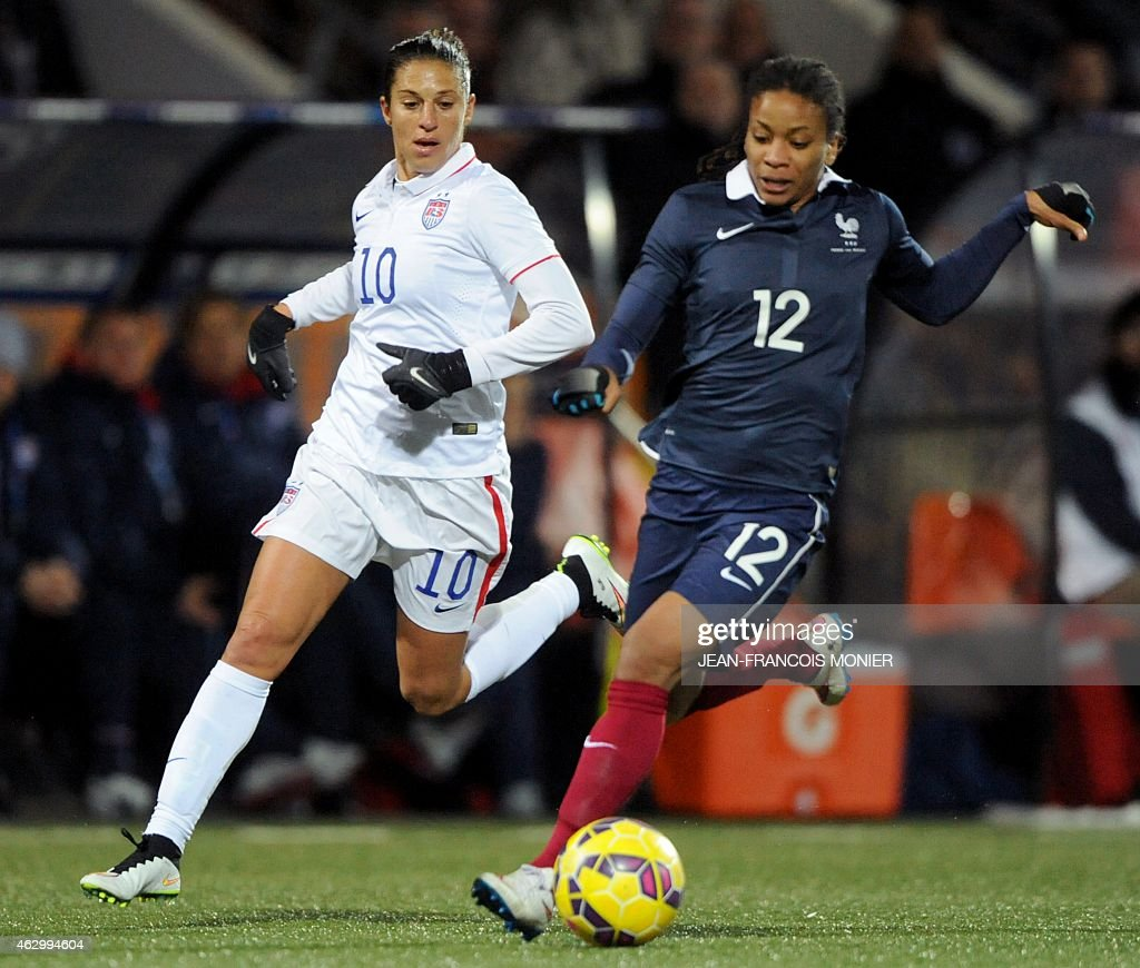 US' midfielder <a gi-track='captionPersonalityLinkClicked' href=/galleries/search?phrase=Carli+Lloyd&family=editorial&specificpeople=736799 ng-click='$event.stopPropagation()'>Carli Lloyd</a> (L) vies for the ball with France's midfielder <a gi-track='captionPersonalityLinkClicked' href=/galleries/search?phrase=Elodie+Thomis&family=editorial&specificpeople=813220 ng-click='$event.stopPropagation()'>Elodie Thomis</a> (R) during the Women's friendly football match France vs USA on February 8, 2015, at the Moustoir Stadium, in Lorient, western France.