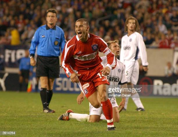 Midfielder Chris Armas of the Chicago Fire reacts after scoring the gamewinning goal in extra time against the Colorado Rapids during a game on...
