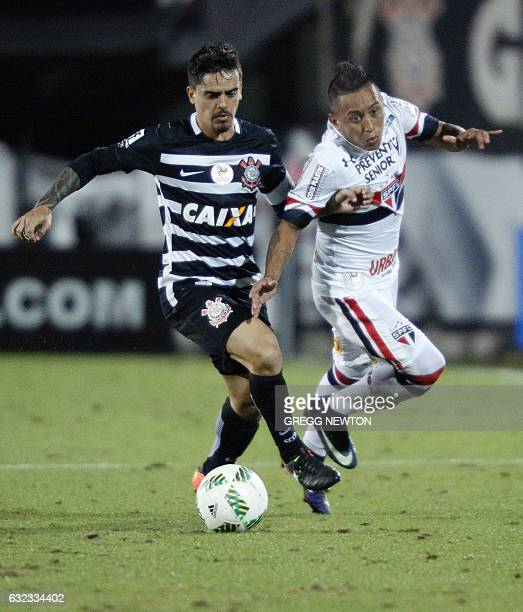Midfielder Christian Cueva of Sao Paulo FC vies for the ball with midfielder Thiago Mendes of Corinthians during the all Brazilian final of the...