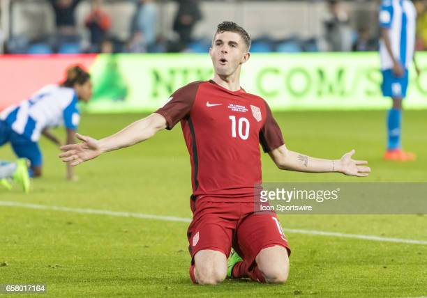 S midfielder Christian Pulisic celebrates his goal with a slide during the FIFA World Cup Qualifier between the US Men's National team and the...