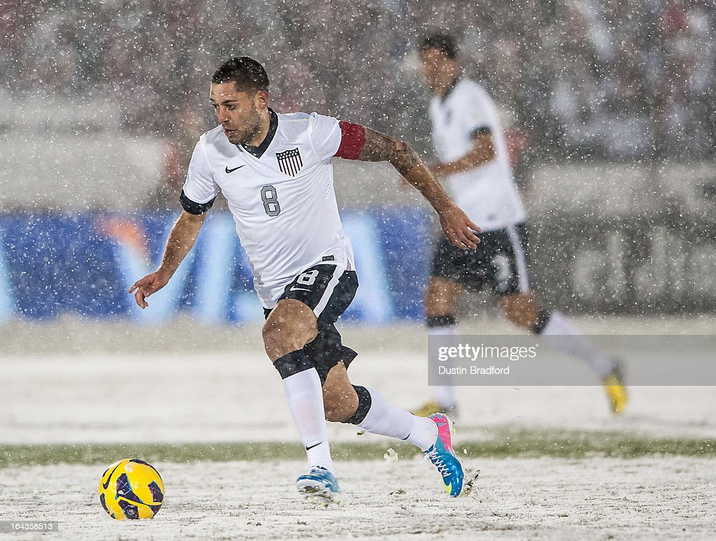Midfielder <a gi-track='captionPersonalityLinkClicked' href=/galleries/search?phrase=Clint+Dempsey&family=editorial&specificpeople=547866 ng-click='$event.stopPropagation()'>Clint Dempsey</a> #8 of the United States dribbles the ball during a FIFA 2014 World Cup Qualifier match between Costa Rica and United States at Dick's Sporting Goods Park on March 22, 2013 in Commerce City, Colorado.