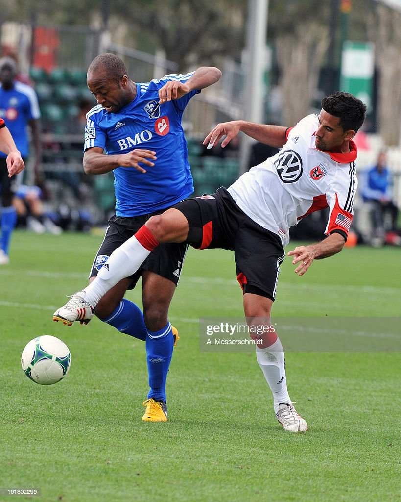 Midfielder Collen Warner #18 of the Montreal Impact battles midfielder <a gi-track='captionPersonalityLinkClicked' href=/galleries/search?phrase=Marcelo+Saragosa&family=editorial&specificpeople=178311 ng-click='$event.stopPropagation()'>Marcelo Saragosa</a> #11 of DC United February 16, 2013 in the third round of the Disney Pro Soccer Classic in Orlando, Florida.
