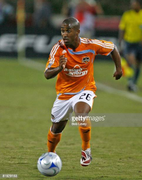 Midfielder Corey Ashe of the Houston Dynamo looks for a teammate to pass to as he bring the ball up the field against Atlante FC during SuperLiga on...