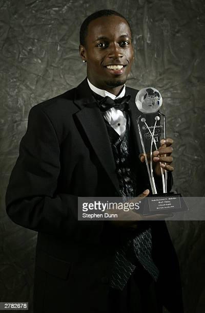 Midfielder DaMarcus Beasley of the Chicago Fire holds the trophy during the MLS Gala Awards Ceremony at the Kodak Theatre on November 22 2003 in Los...
