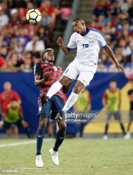 Midfielder Daniel Herelle of Martinique heads the ball away from midfielder Gyasi Zardes of the United States during the second half of their Group B...