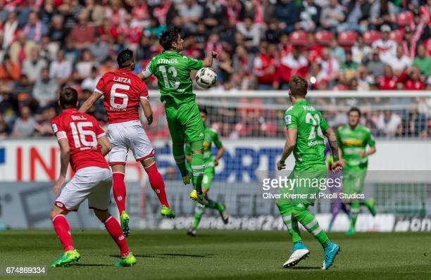 Midfielder Danny Latza of FSV Mainz 05 and Forward Lars Stindl of Borussia Moenchengladbach missing the headball during the 1 Bundesliga match...