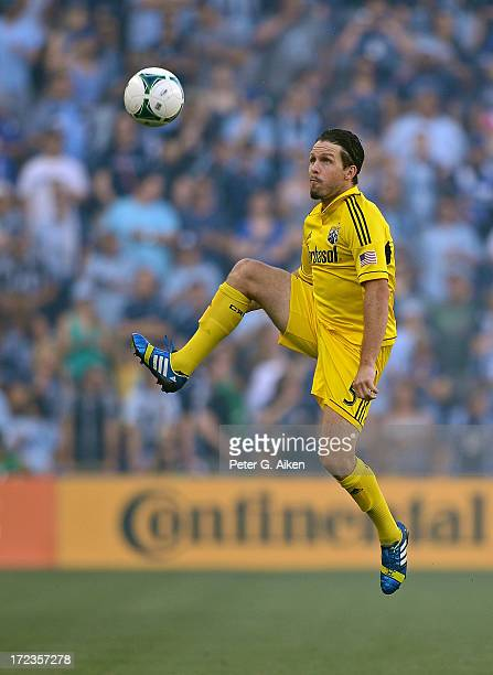 Midfielder Danny O'Rourke of the Columbus Crew leaps into the air for the ball against Sporting Kansas City during the first half on June 29 2013 at...