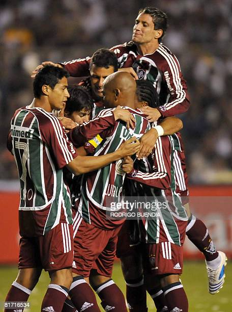Midfielder Dario Conca of Brazil's Fluminense celebrates with teammates after scoring a goal against Liga de Quito of Ecuador during their Copa...