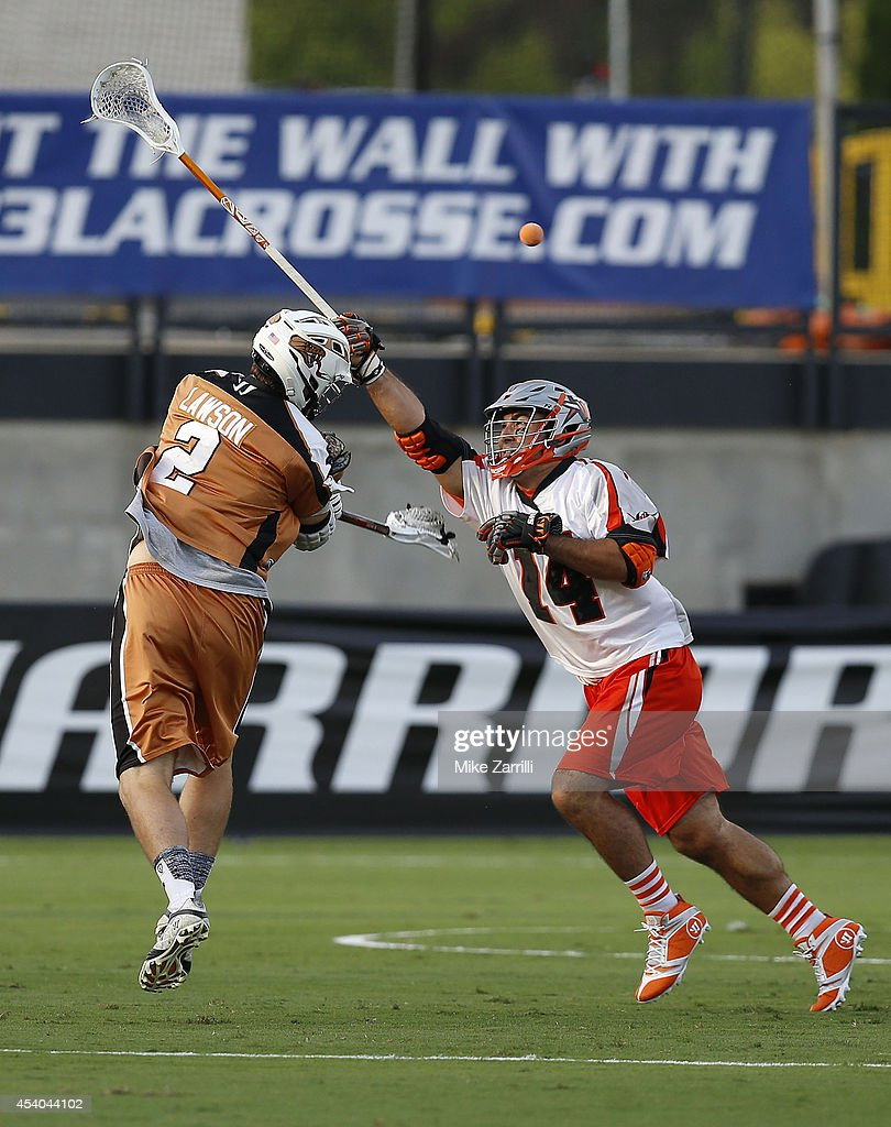 Midfielder Dave Lawson #2 of the Rochester Rattlers shoots over midfielder Justin Pennington #14 of the Denver Outlaws during the 2014 Major League Lacrosse Championship Game at Fifth Third Bank Stadium on August 23, 2014 in Kennesaw, Georgia.