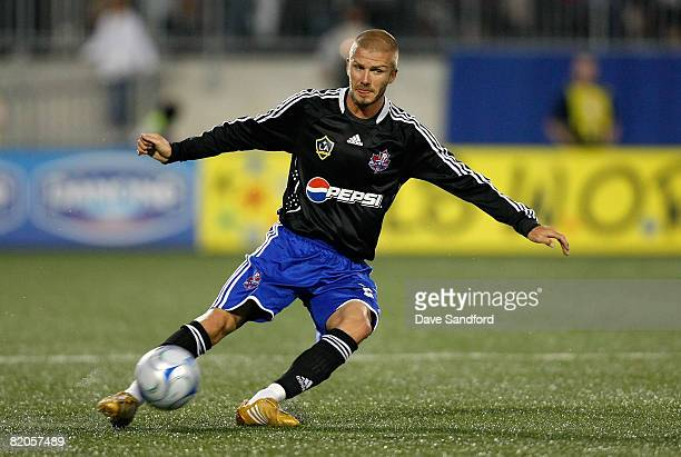 Midfielder David Beckham of LA Galaxy crosses the ball during the 2008 Pepsi MLS All Star Game between the MLS All Stars and West Ham United at BMO...
