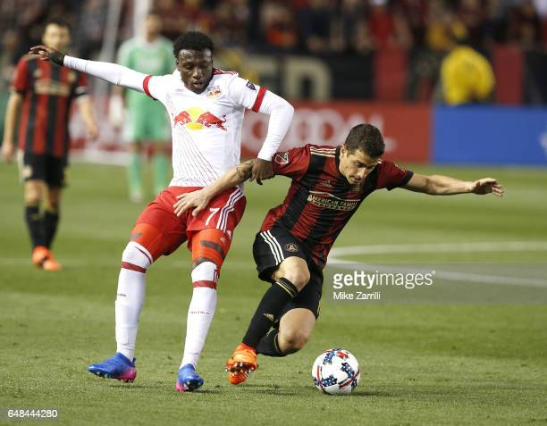 Midfielder Derrick Etienne Jr #7 of the New York Red Bulls battles for the ball with midfielder Carlos Carmona of Atlanta United during the game at...